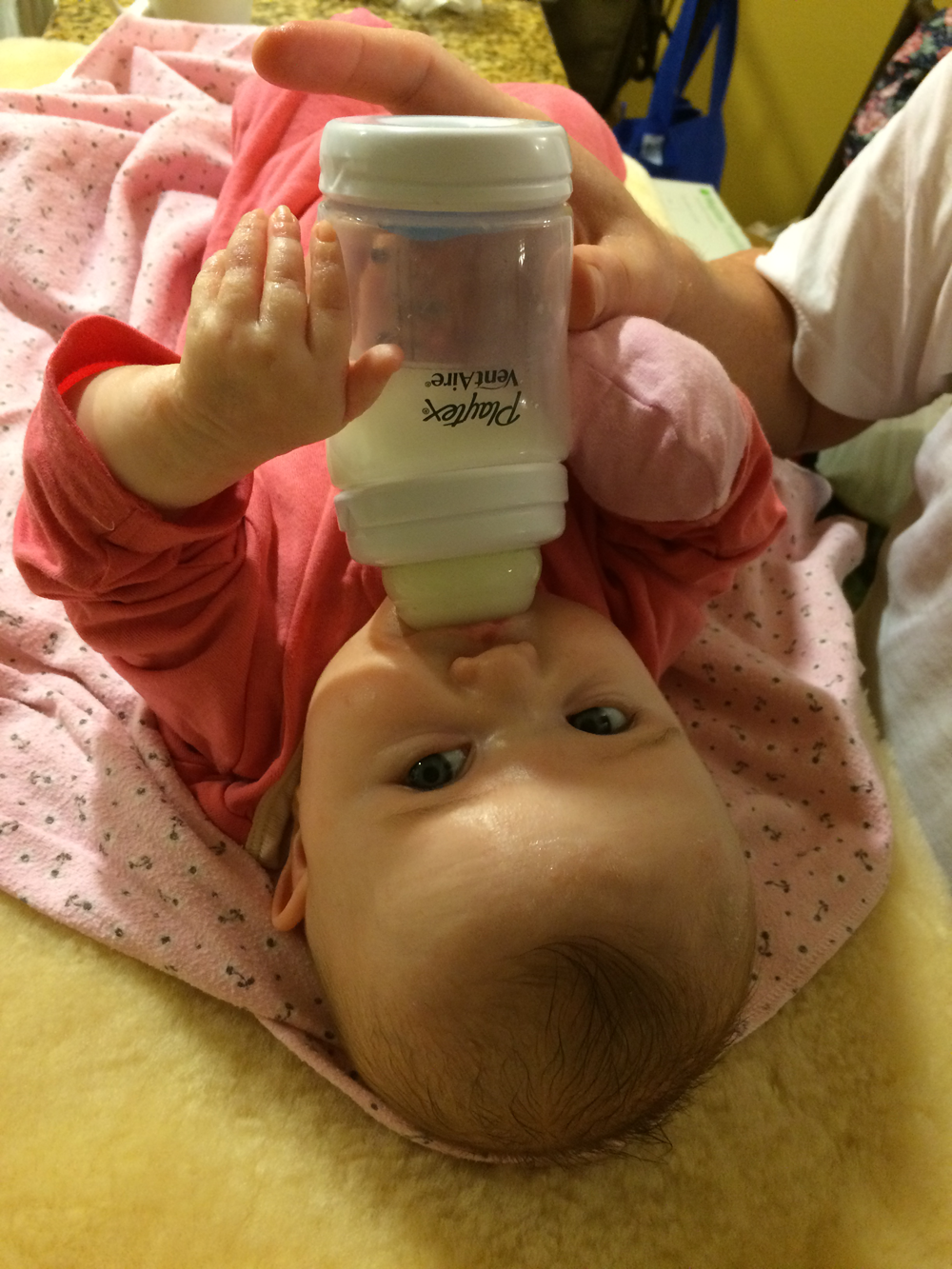 Holding her bottle